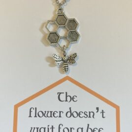 Blossoms and then the bee comes: 20″ Stainless Steel Necklace